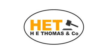 H E Thomas & Co Solicitors logo